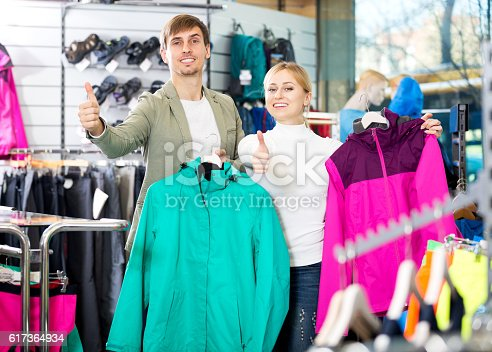 istock Couple shopping clothing in the store 617364934