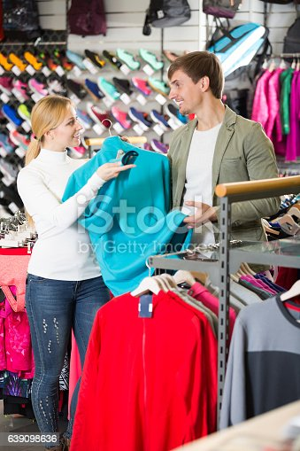 istock Couple shopping clothing in the store 639098636