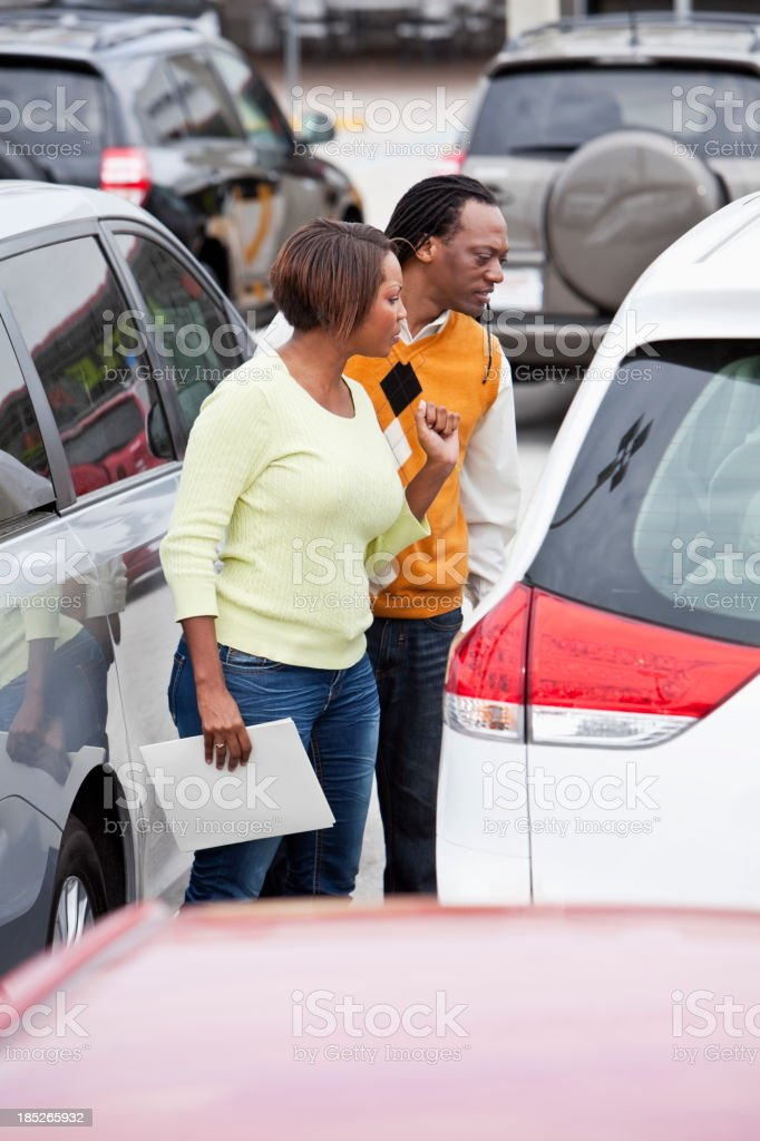 Couple shopping for car royalty-free stock photo