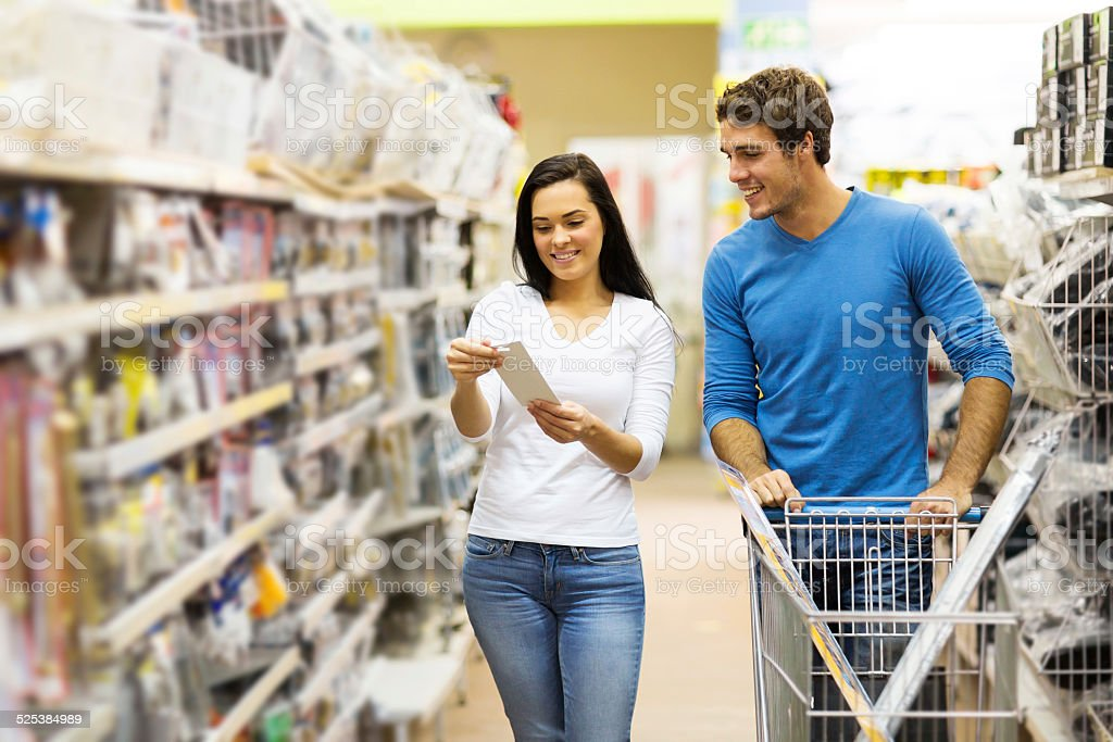 couple shopping for DIY tools stock photo