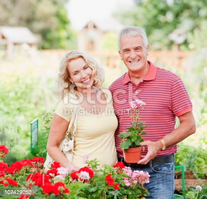 istock Couple shopping for flowers in nursery 107429252