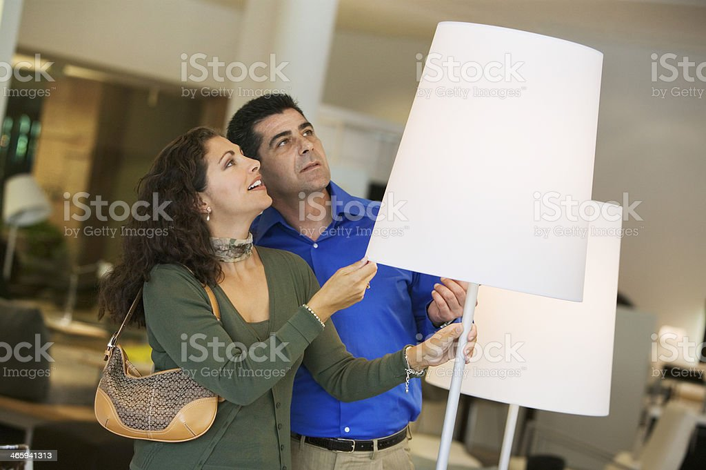 Couple Shopping For Lamps stock photo