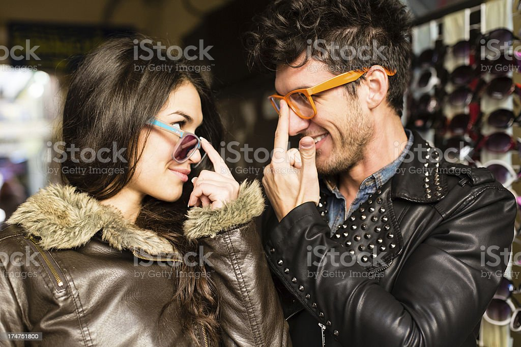 Couple shopping for sunglasses royalty-free stock photo