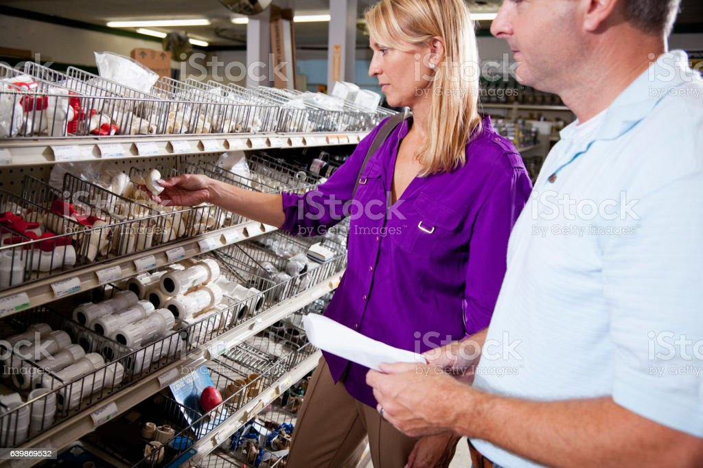Couple shopping in hardware store stock photo