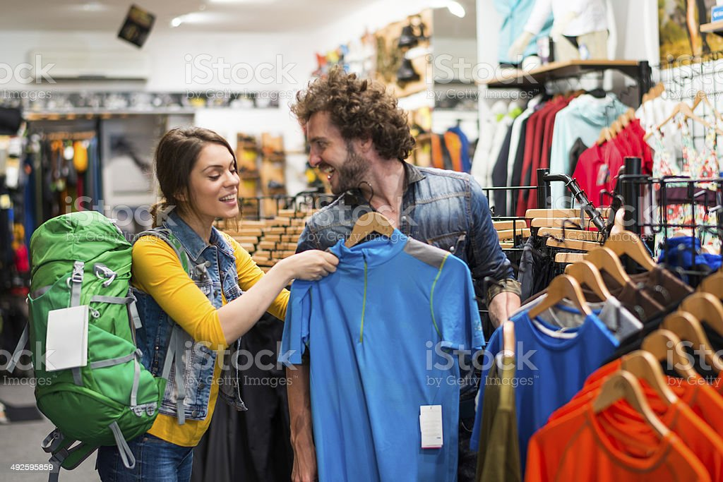 Couple shopping in sports store stock photo