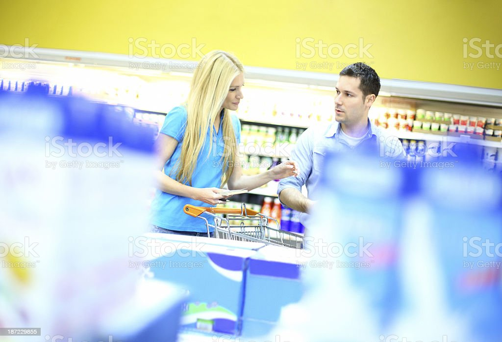 Couple shopping in supermarket. royalty-free stock photo