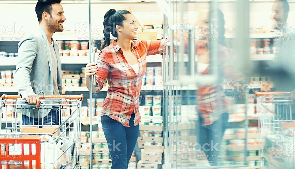 Couple shopping in supermarket. stock photo