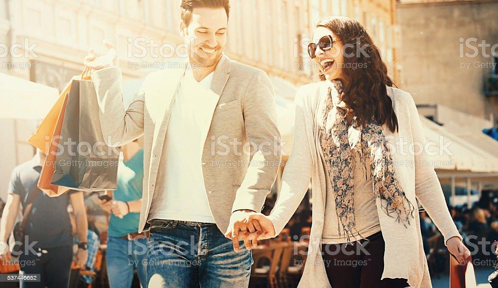 Couple shopping on sunny summer day. stock photo