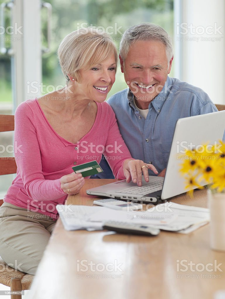 Couple shopping online on laptop at home royalty-free stock photo