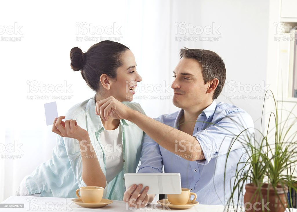 Couple shopping online stock photo