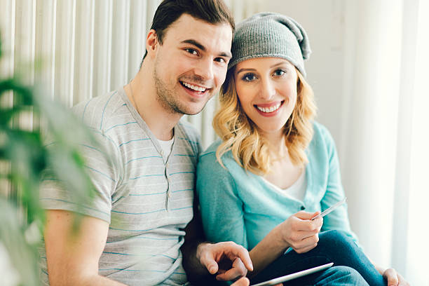 couple shopping online with tablet. - testimonial stock photos and pictures