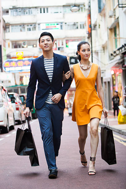 Couple Shopping Couple shopping in Hong Kong shopping couple asian stock pictures, royalty-free photos & images