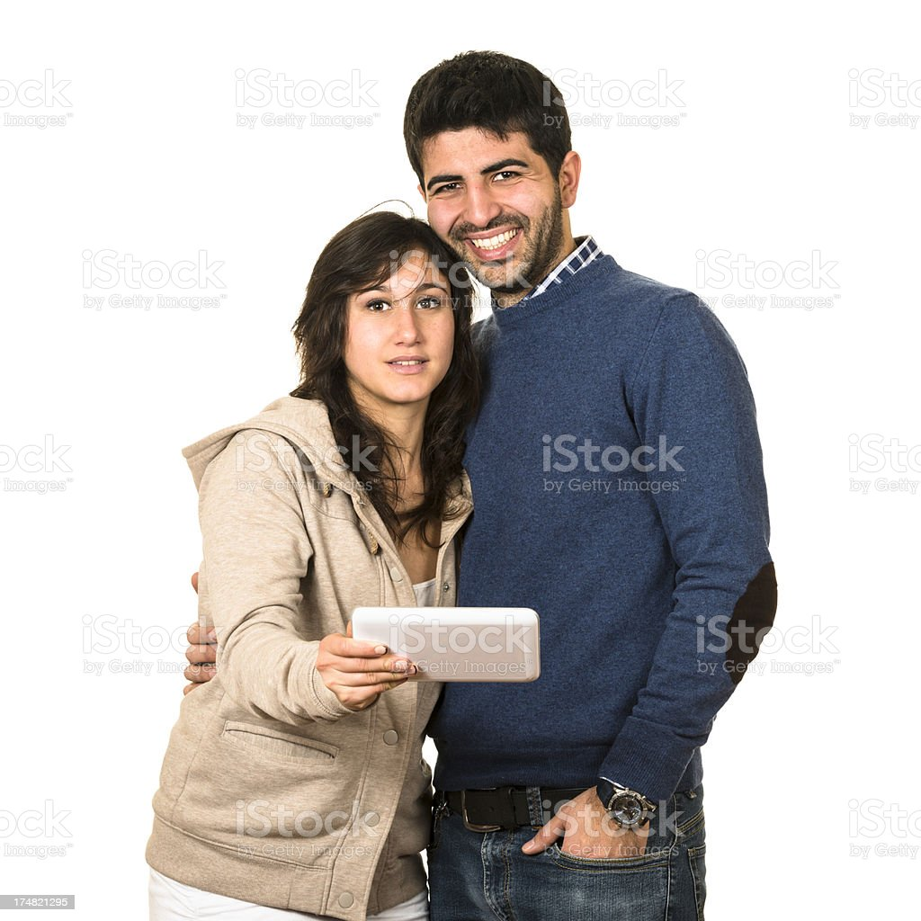 couple showing his tablet royalty-free stock photo