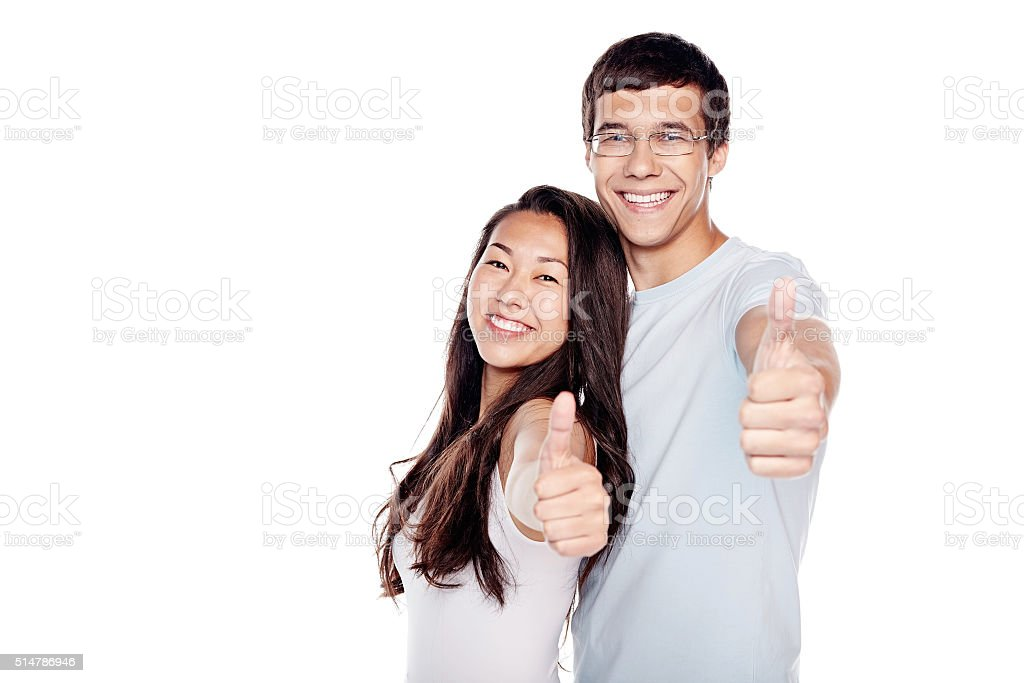 Couple showing thumb up sign stock photo