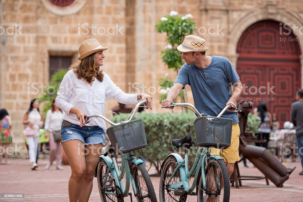 Couple sightseeing on bikes in Cartagena stock photo