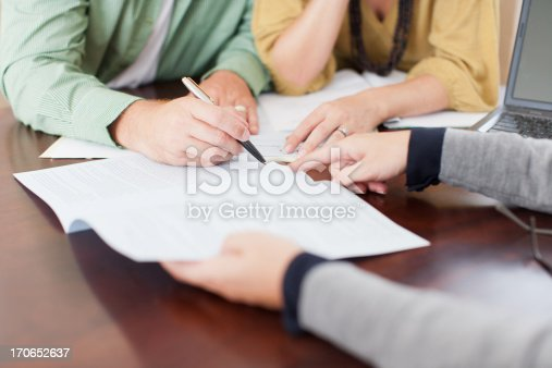 istock Couple signing contract 170652637