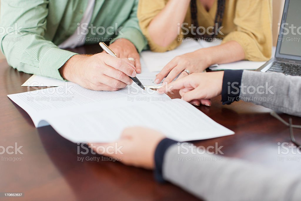 Couple signing contract stock photo