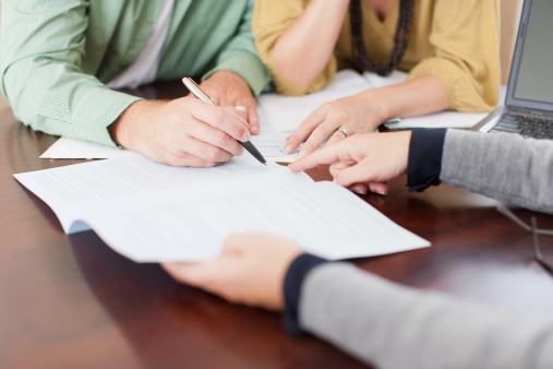 Couple Signing Contract Stock Photo - Download Image Now
