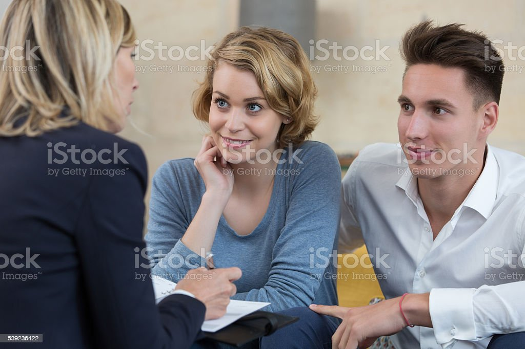 couple signing financial contract royalty-free stock photo