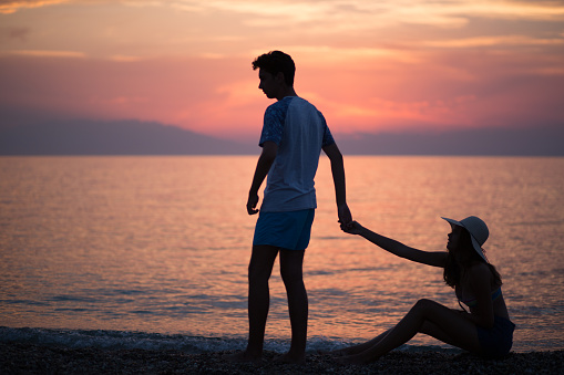 Couple Silhouette Breaking Up A Relation On The Beach At Sunset Stock Photo  - Download Image Now - iStock