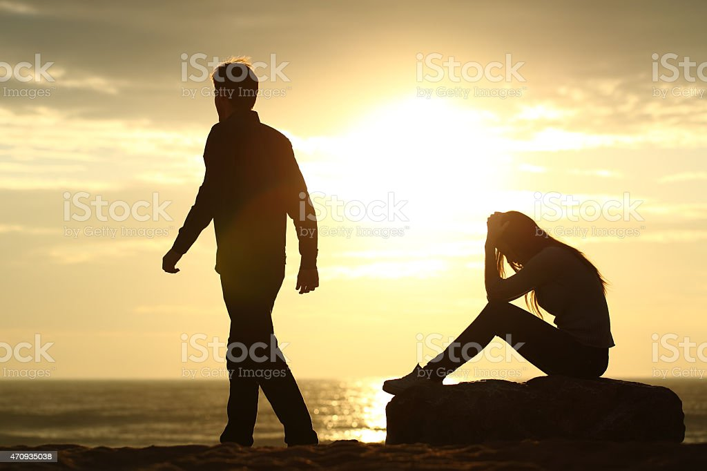 Couple silhouette breaking up a relation stock photo