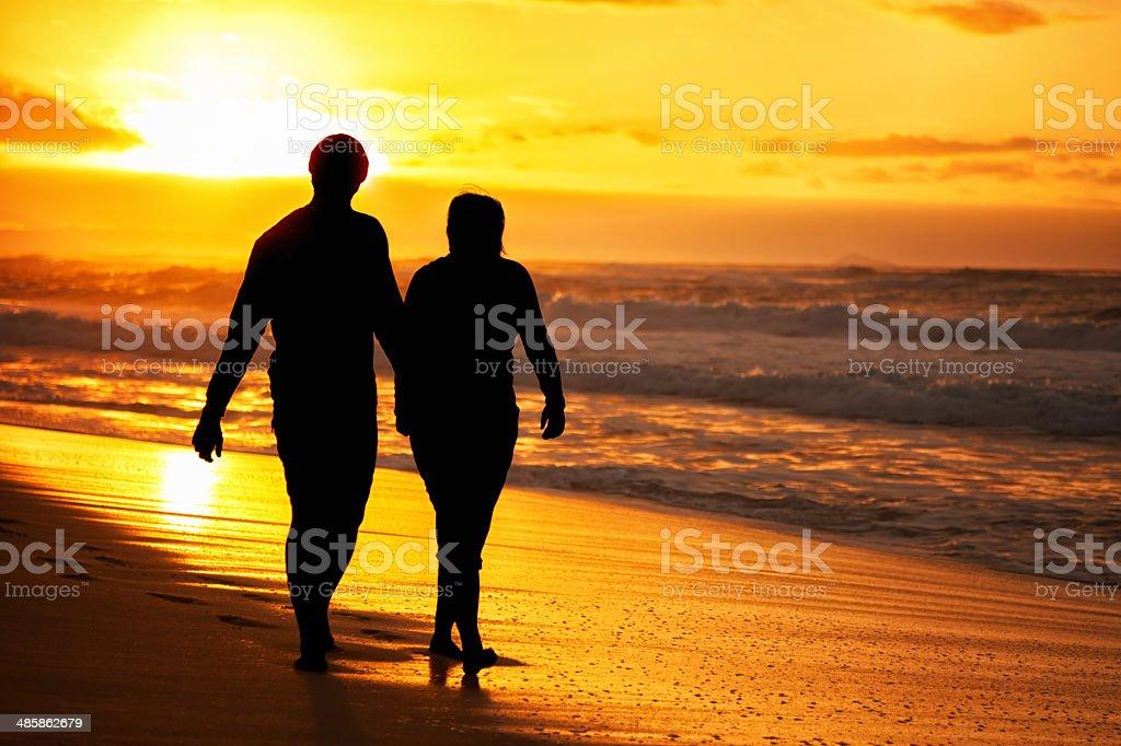 Couple Silhouette on Beach royalty-free stock photo