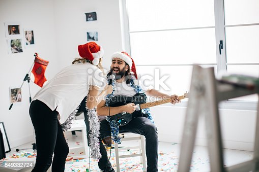 849362192 istock photo Couple singing a christmas song 849332724