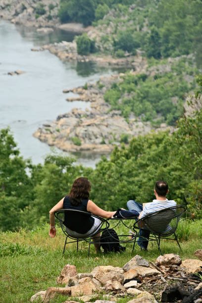 Couple sitting and taking in the scenery below stock photo