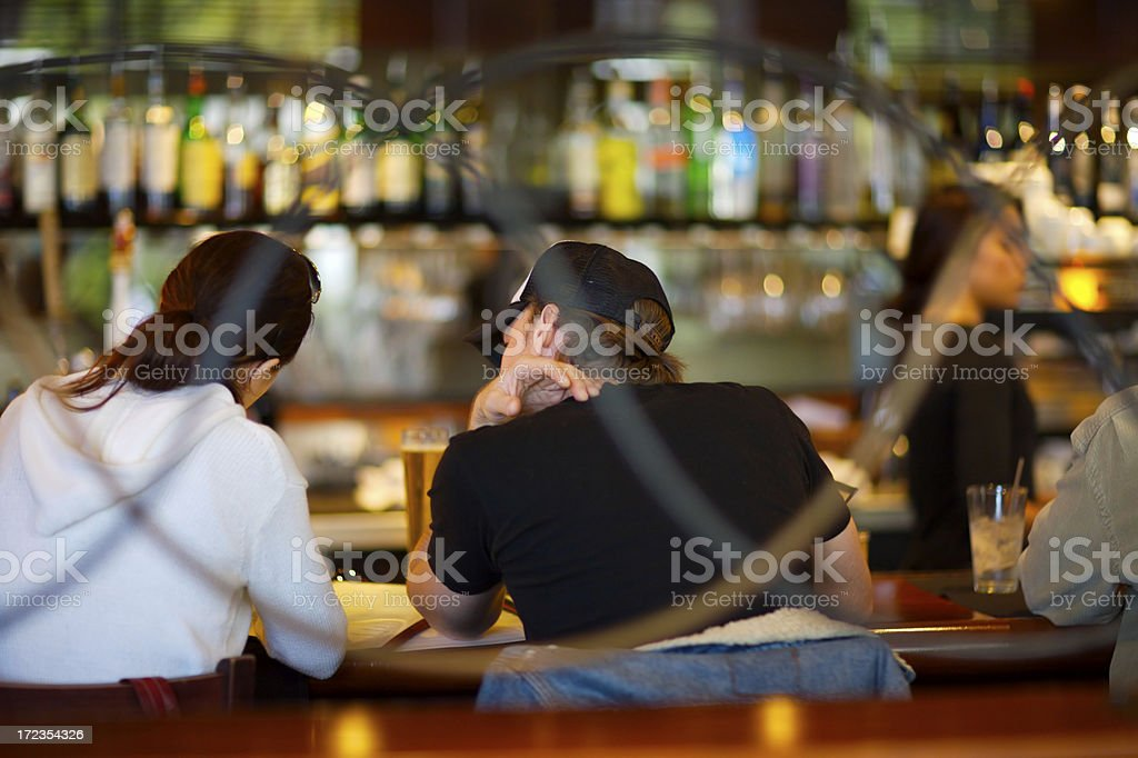Couple sitting at bar royalty-free stock photo