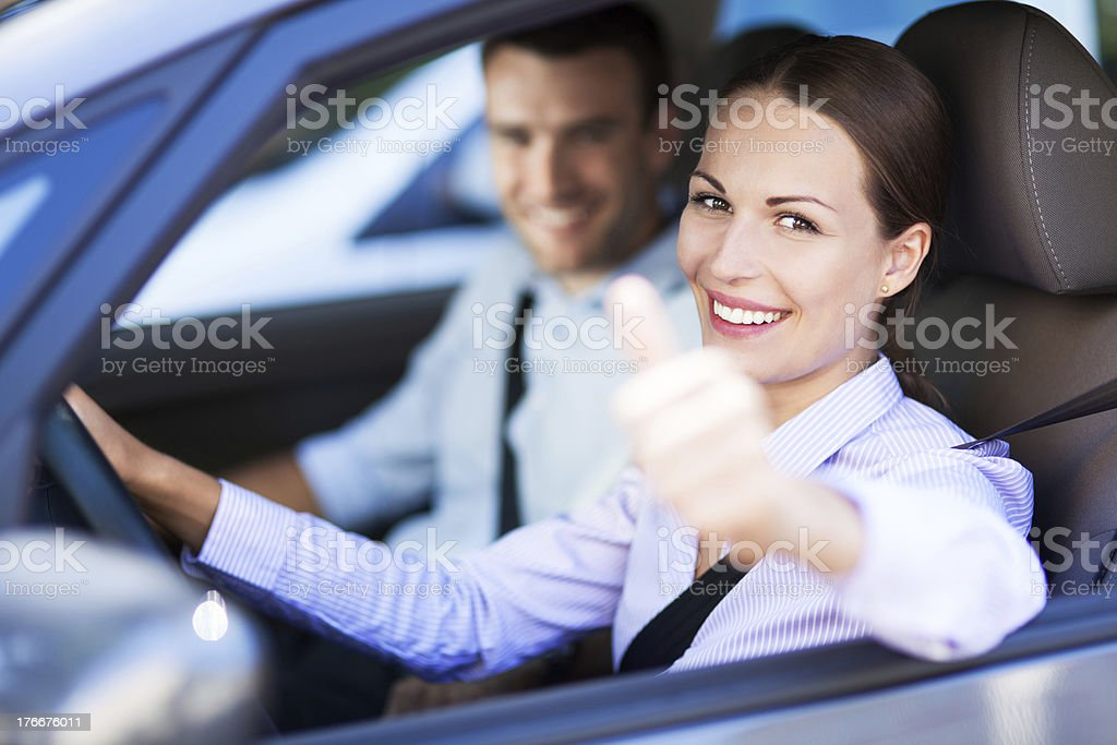 Couple sitting in car with thumbs up royalty-free stock photo