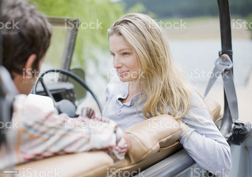 Couple sitting in jeep royalty-free stock photo