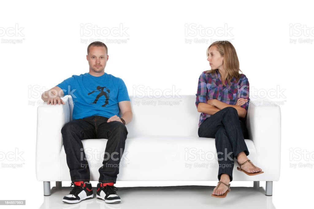 Couple sitting on a couch stock photo
