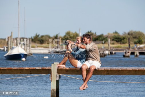 istock Couple sitting on a dock 110052790