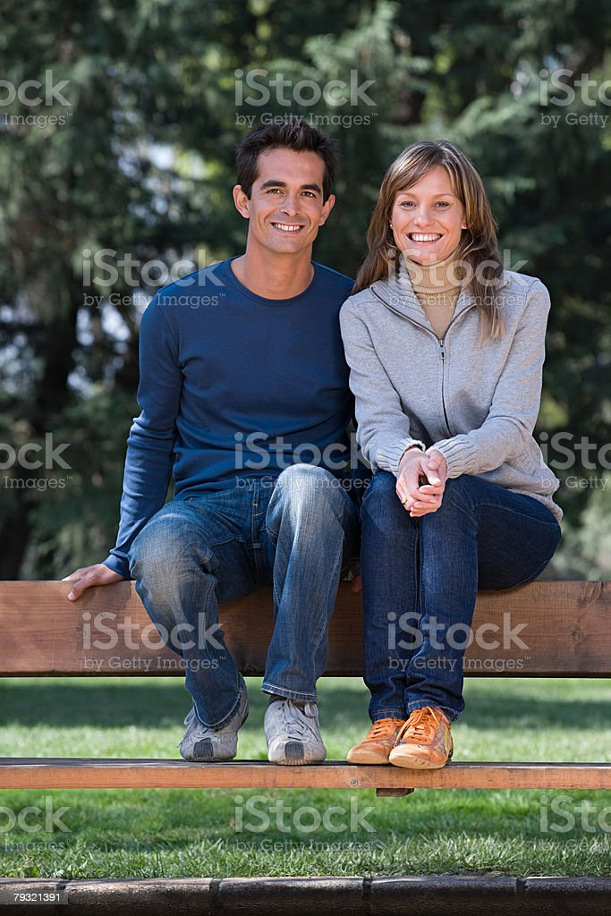 Couple sitting on bench royalty-free 스톡 사진