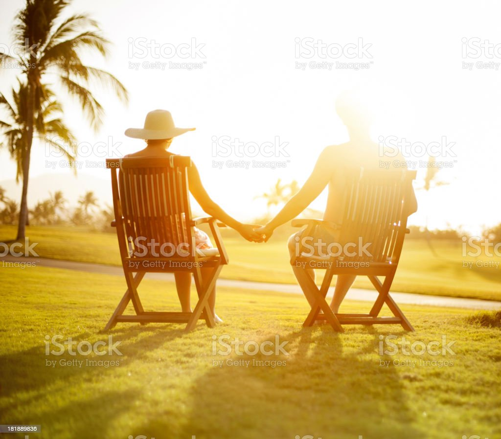 Couple sitting on chairs royalty-free stock photo