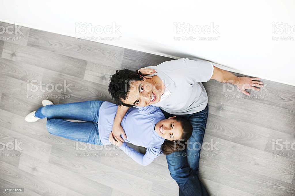 Couple sitting on floor at a new home royalty-free stock photo