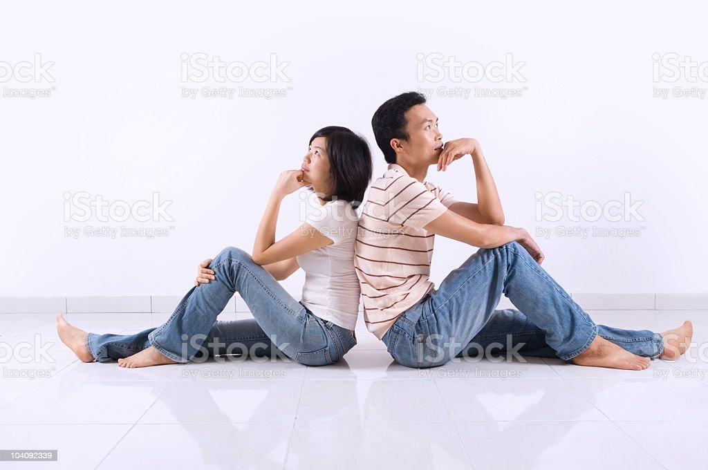 Couple sitting on floor at home. royalty-free stock photo