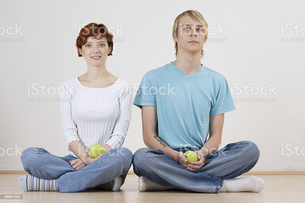 Couple sitting on floor royalty-free stock photo