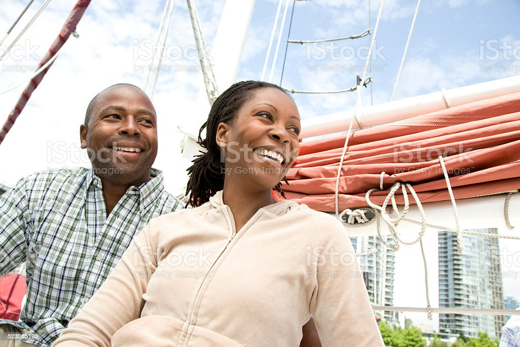 Couple Sitting on Sailboat stock photo