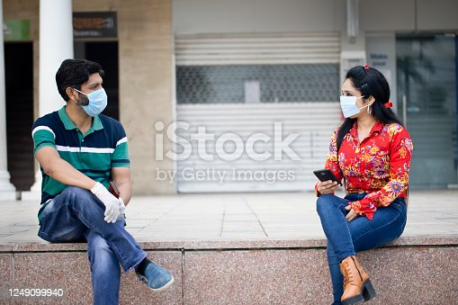 Couple meeting outdoors with social distancing post lockdown