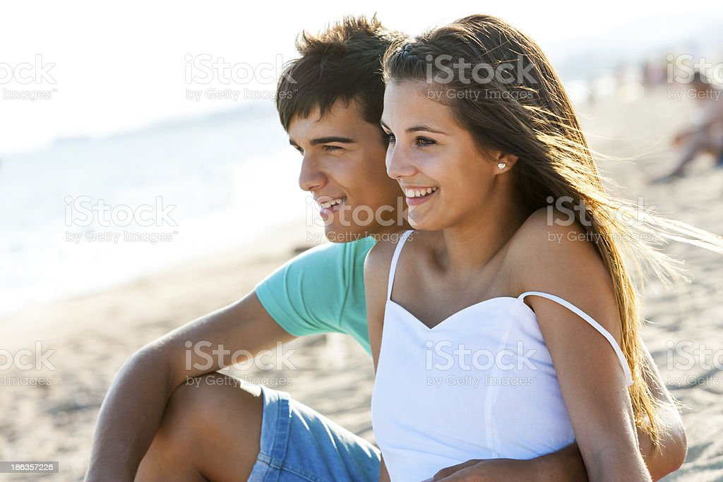 Couple sitting together at sunset. stock photo