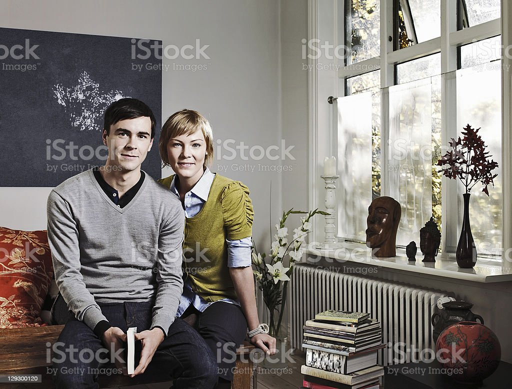 Couple sitting together in living room royalty-free stock photo
