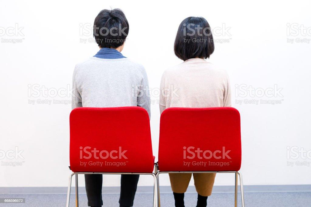 Couple sitting together stock photo