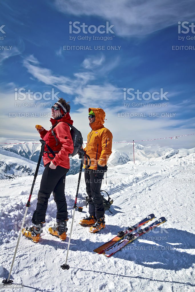 Couple skiers in the mountains royalty-free stock photo