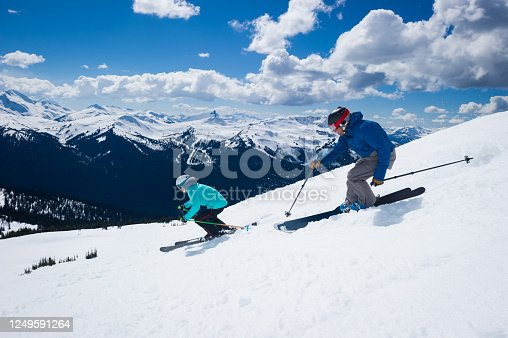 istock Couple skiing in the mountains 1249591264
