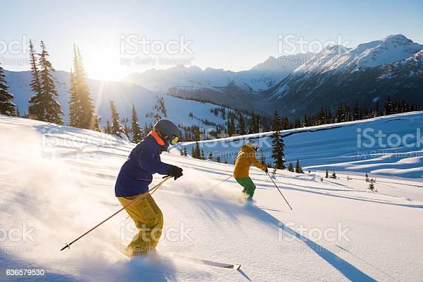 Couple skiing on a sunny powder day picture id636579530?b=1&k=6&m=636579530&s=612x612&h=ckcjx wy2zuzpzolz2yk9hpsesmzljvx5rrk96u6gvc=
