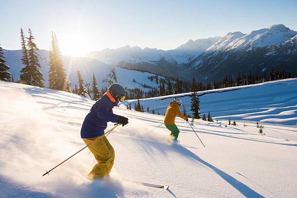 Couple skiing on a sunny powder day picture id636579530?b=1&k=6&m=636579530&s=612x612&w=0&h=uv5tyzqqsv2yayxutopyreu8ip2sdk h6kgfi1yv1ge=