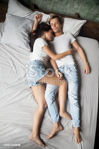 504371332istockphoto Couple sleeping in bed at bedroom at home 1059754946
