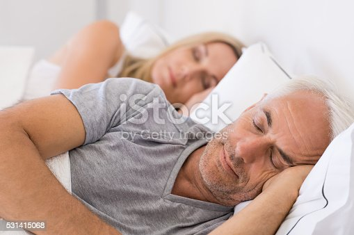 istock Couple sleeping in bed 531415068