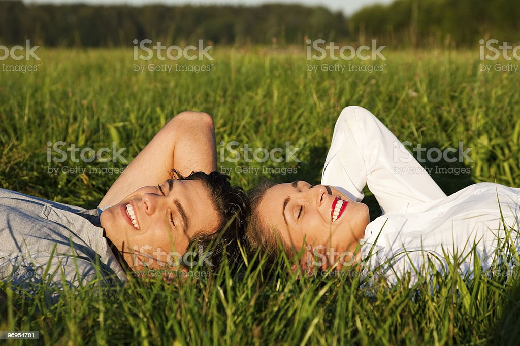 Couple sleeping on meadow in the sunshine royalty-free stock photo